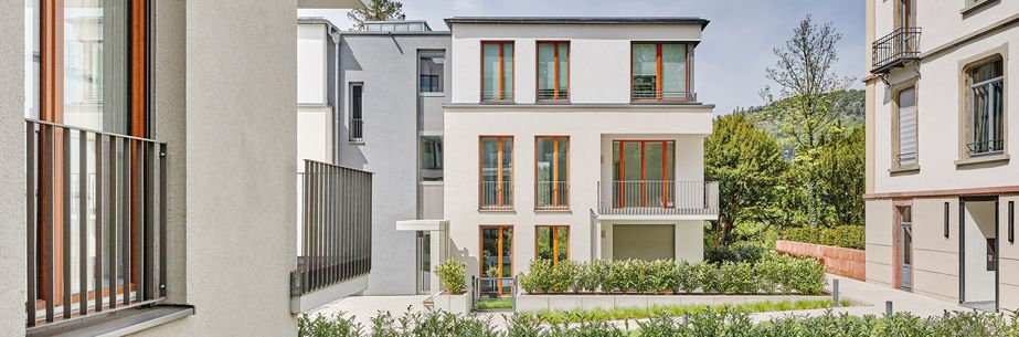 modern multi family house with wooden windows in a green area