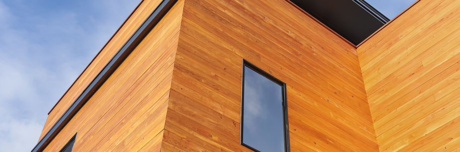 modern timber house, wooden paneling, natural wooden front of a house